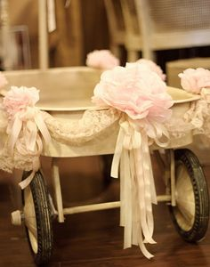 Cute with yellow flowers and blue ribbons? Or painted blue? Maybe less lace...one of the flower girls could wheel it down the aisle!