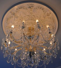 large decorative ceiling medallion and crystal chandelier -