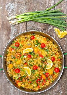 holiday in spain cauliflower rice vegetable paella cooking time: 20 minutes servings: 4 - 6 grocery list: 1 tbsp coconut oil 1 small onion, diced 1 small red bell pepper, diced 1 small green bell. Rice Recipes, Veggie Recipes, Whole Food Recipes, Vegetarian Recipes, Cooking Recipes, Healthy Recipes, Cooking Time, Vegan Meals, Cauliflower Recipes