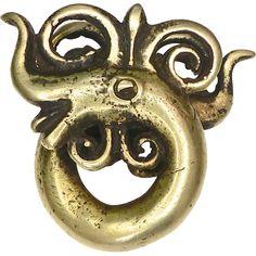 Antique Solid Brass Earring From Dayak Kalimantan, Borneo from carolbarrettjewelry on Ruby Lane