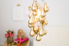 DIY This Gold-Dipped Light Bulb Chandelier.
