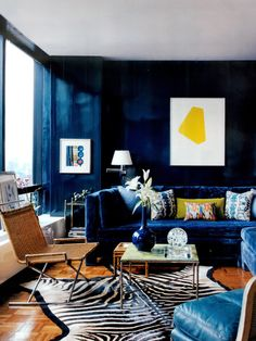 Ink blue... Design: Robert Rufino. Photo: Thomas Loof What about midnight blue and canary yellow with bright white? or is the wood floor and chartreuse pillow what brings it all together in balance?