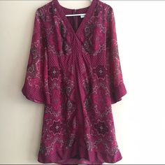 New York & Company pink empire waist dress Preloved. Back tie to adjust to your measurements as well as a zipper at the neckline. Flowy bell sleeves that are unlined. Body of the dress is lined with a soft material. New York & Company Dresses