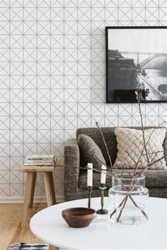 """Scandinavia Nordic style living room in white, finished with 4"""" pure white triangle tiles for wall cladding. Get inspiration for your next home decoration ideas"""