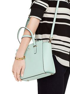 A handbag that falls on the hips draws attention to this area and you might not want this so pay attention to where it falls. ( Ladies with A body types might not want this)