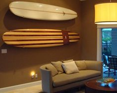 No need to bring in a coastal surf theme with a surfboard painting—how about hanging the real thing? For those of us who are familiar with s...