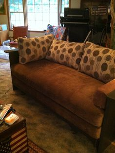 Look what a twin bed, two old doors, upholstery fabric and pillows can make! Viola a new couch under $50.00