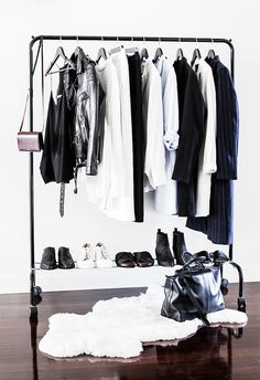 Makeshift closet ideas // Black clothing rack + white rug + wood floors