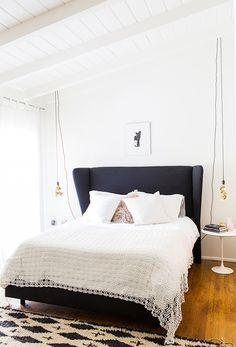 Black headboard and base in in the relaxed and light-filled L.A home of Victoria from SF Girl By Bay. Laure Joliet.