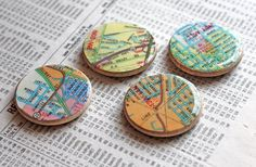 Map magnets made by gluing pieces of a map to wooden disks with Mod Podge Dimensional Magic.