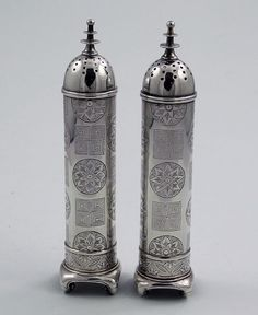 Tiffany Sterling Antique Pepper Shakers    A pair of unusual tall antique sterling pepper shakers by Tiffany and Co engraved with Japanese motifs and monogrammed in the center of the cartouche on the front of each shaker. Circa 1880.