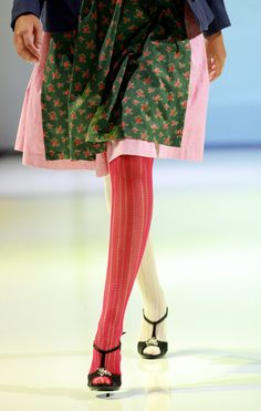 A model walks the runway wearing a dirndl dress