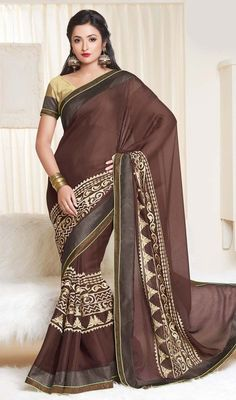 Designer saddle brown crepe silk sari with contrast blouse makes perfect combo for evening get together. The sari is beautified with lace and contrast beige silk thread embroidered border in a unique style which adds charm and grace to your beauty. The sari comes with contrast beige raw silk stitched blouse as shown in the picture. #LatestEveningWearSarees