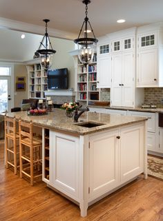 White kitchen - with neutral countertop, and neutral toned backsplash.