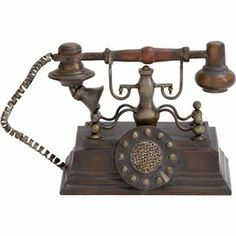 "Vintaged metal telephone decor in bronze with a weathered finish.         Product: Telephone décorConstruction Material: MetalColor: BronzeDimensions: 7"" H x 11"" W  Note: For decorative use only  Cleaning and Care: Not recommended for outdoor use. Wipe with dry cloth."