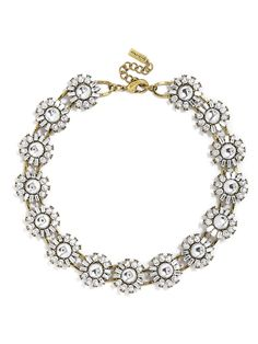 A simple floral motif makes an elegantly versatile strand--rounded crystal cabochons add an unexpected touch.