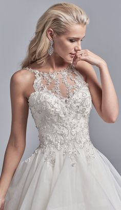 Sottero and Midgley - MURPHY, Shimmering lace motifs accented with beading and Swarovski crystals cascade over the bodice of this ballgown wedding dress, completing the illusion halter over sweetheart neckline and scoop back.