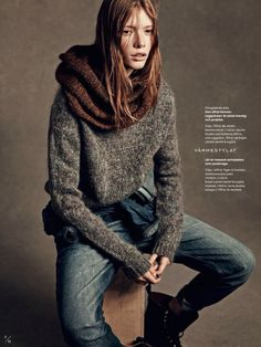 Infinity scarf, knit sweater, and combat boots from Elle Sweden. // Photo by Andreas Sjodin.
