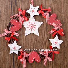 Christmas wreath hanging ornament with wooden stars and hearts