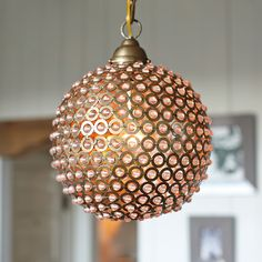 Serena & Lily Marmont Pendant Handmade of slightly opaque recycled glass beads, with an iron frame and a brass finish.