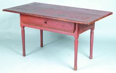 "Early CT Tavern Table with original red paint, two part top with applied ends, full length dovetailed drawer with turned wood pull, pegged mortised construct, turned legs, 26-½""h. x 50""w. x 27-½""d., (legs shortened, losses to drawer, good patina, natural paint wear)."