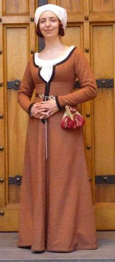 (completed May 2014) Photo taken by Claudia Linder.  This gown was made to bridge the gap between my peach linen kirtle (warm weather wear) and black wool gown (freezing weather wear), and to b...