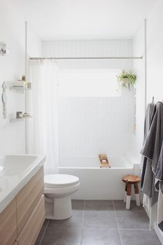 so excited to share the finished bathroom with you! if you forget what the room looked like before, here's the refresher. we tore everything out and started from scratch, but i still thought…
