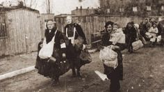 Lodz Ghetto residents head toward the trains that will take them to Chelmno extermination camp, in Poland (photo credit: unknown)