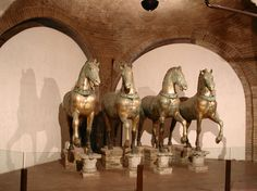 The horses were spoils of war. They were captured from Constantinople in 1204 during the Fourth Crusade. Since the days of Constantine, they had stood harnessed to a chariot at the Hippodrome, while it was used as the racing stadium. For another eight centuries, they stood over the doors to St. Mark's in Venice. Now, they're protected inside a museum.