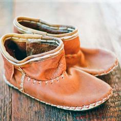 Handmade leather slip-on booties with with decorative leather flap, leather detail stitching and contrast stitching around the recycled rubb...