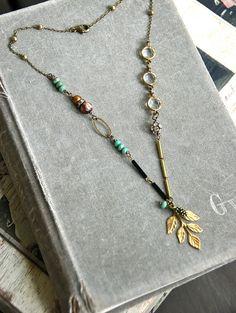 Tabitha. Golden leaf rhinestone jeweled gemstone by tiedupmemories