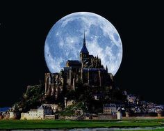 full moon behind moint-saint michel