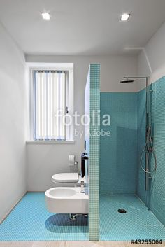 """Download the royalty-free photo """"cabina doccia in muratura a sanitari in un bagno moderno"""" created by adpePhoto at the lowest price on Fotolia.com. Browse our cheap image bank online to find the perfect stock photo for your marketing projects!"""