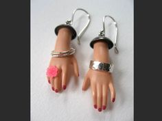 Margaux Lange is a jewelry artist from USA. She create unique and original jewelry using utilizes salvaged Barbie doll parts in combination with sterling silver and pigmented resins. Weird Jewelry, Unusual Jewelry, Body Jewelry, Jewelry Crafts, Jewelry Art, Jewelry Design, Diy Jewelry Recycled, Bijou Halloween, Halloween Jewelry
