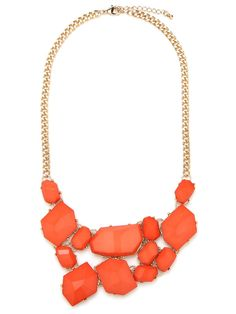 BaubleBar  Persimmon Mosaic Bib  Oversized stones in the brightest of hues eschew classic statement pop for a dose of downtown edge. A slightly off-kilter asymmetrical array of stonework is just left of center, and oh-so-cool.