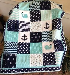 This Baby Whales quilt is Lovesewnseams signature quilt. It was designed from my love of whales and the ocean. This version adds the anchor, the true nautical symbol. The 100% Cotten quilting fabrics in Aqua, navy and white coordinate beautifully with the hand stitched and appliquéd whales and anchors.  Backed in soft ultra cuddly fabric in Aqua or Teal, machine quilted and beautifully bound edges. The quilting gives this blanket dimension, durability and adds to the quality. Most baby/crib…