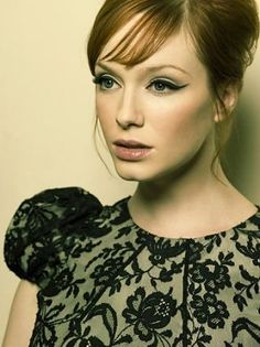 Cat-eyed Joan.  I will learn to apply make-up like this. Maybe.