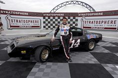 """Tony Stewart poses with his """"Smoke IS the Bandit"""" ride in victory lane at Las Vegas Motor Speedway. View more photos from Las Vegas here: http://www.stewarthaasracing.com/media/gallery/index.php"""
