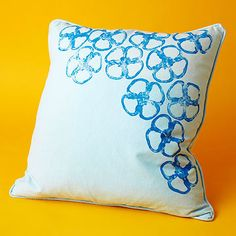 Grow a flower patch on your throw pillow with a green bell pepper and a bit of paint.