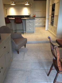 Antiqued grey stone tiles have been used to create this grey stone kitchen floor - Antiqued Grey Barr limestone Click the image to read more! Flagstone Flooring, Limestone Flooring, Natural Stone Flooring, Grey Flooring, Kitchen Flooring, Kitchen Tiles, Flooring Ideas, Stone Kitchen Floor, Stairs In Kitchen