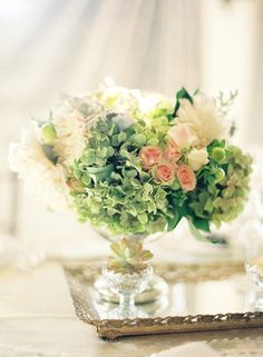 Green and rose floral arrangement.   Photo by Jose Villa Photography