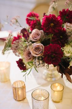 Fall Wedding in the Utah State Capitol Building, Low Centerpieces with Dahlias, Roses, and Brunia Berries | Brides.com