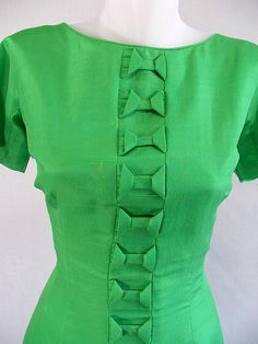 really cool bow detail. green silk vintage dress