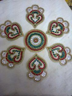 http://www.tradeindia.com/fp1257138/Kundan-Rangoli.html