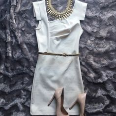Bebe Asymmetric Neckline Dress Bebe cream colored dress in good used condition.   Great neutral dress u can add a variety of accessories to for a New Look ea time u wear it!  True to sz.   Skinny gold waist belt included.   I also have the same dress in coral for sale in my closet bebe Dresses Mini