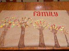 A Family Art Project.....trunks are made out of each family member's hand and leaves are thumbprints