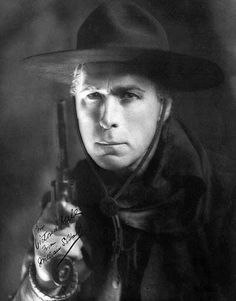 William S. Hart 1870–1946 - Having worked on cattle ranches  growing up in the Midwest, actor William S. Hart brought a degree of authenticity to his roles as a  cowboy and outlaw. An accomplished stage actor on Broadway, he moved to California in 1913 to act in The Bargain, the first of more than thirty western movies in which he starred.This pic of Hart holding a revolver and wearing a Mountie-style hat and scarf captures the classic cowboy image that he popularized during the 1910s and…