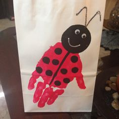 Ladybug goody bags with the birthday girl's handprint