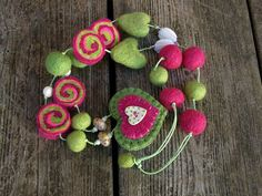wet felted necklace with lovely lampwork beads by Nimblejacks, via Flickr