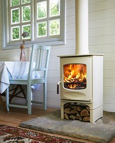 White wood burning stove on stone hearth Corner Wood Stove, Wood Stove Hearth, Stove Fireplace, Log Burner, Into The Woods, White Wood, Black Wood, My Living Room, Family Room